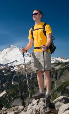 A hiker with two hiking sticks.
