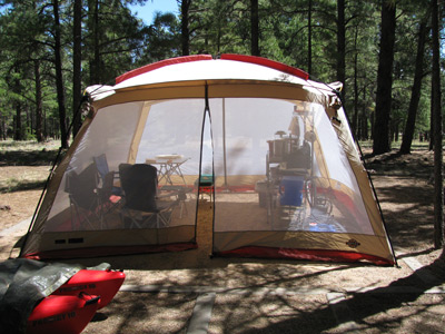 "Out outdoor ""kitchen."" With the tips of the kayaks under their tarp in the lower left corner."