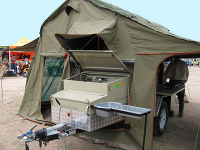 Another tent on top of a cargo trailer.